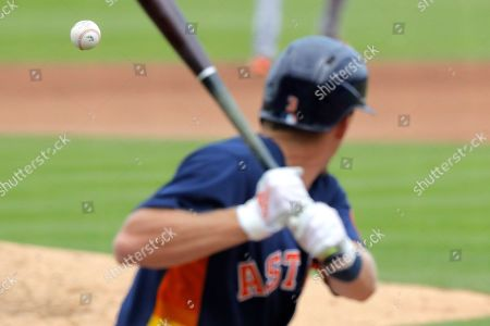 A pitch from Detroit Tigers pitcher David McKay makes its way to Houston Astros batter Myles Straw during the fourth inning of a spring training baseball game, in West Palm Beach, Fla