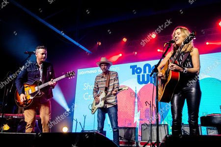 Stock Photo of Sheryl Crow; Todd Snider; Jason Isbell. Jason Isbell, from left, Todd Snider, and Sheryl Crow perform at the To Nashville, With Love Benefit Concert at Marathon Music Works, in Nashville, TN