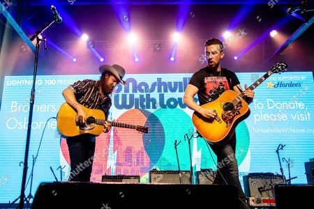 John Osborne; T.J. Osborne. John Osborne, left, and T.J. Osborne of Brothers Osborne perform at the To Nashville, With Love Benefit Concert at Marathon Music Works, in Nashville, TN