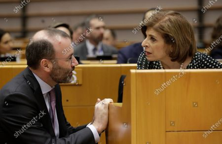Leader of the European People's Party at the European Parliament, Manfred Weber (L) and European Commissioner in charge of Health, Stella Kyriakides (R) attend a debate on the novel coronavirus Covid-19 during a plenary session of the European Parliament in Brussels, Belgium, 10 March 2020. Due to the novel coronavirus Covid-19 emergency, the plenary session has been reduced to one day.