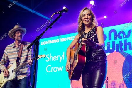 Stock Picture of Audley Freed (L) and Sheryl Crow perform at Music Marathon Works.