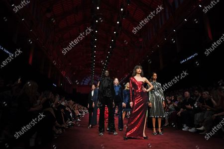 Models present creations by Carla Zampatti during the Gala Runway 1 show at the Melbourne Fashion Festival, in Melbourne, Australia, 10 March 2020.