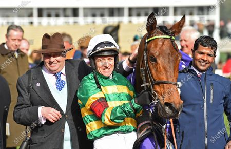 Champ with (L) trainer Nicky Henderson and Barry Geraghty after winning The RSA Insurance Novices Steeple Chase.