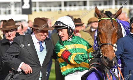 Champ with trainer Nicky Henderson and Barry Geraghty after winning The RSA Insurance Novices Steeple Chase.