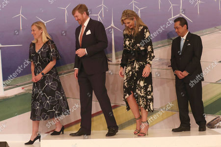 Willem-Alexander, Maxima, Sigrid Kaag, Agus Suparmanto. Netherlands' King Willem-Alexander, second left, and Queen Maxima, second right accompanied with Netherland's Minister for Foreign Trade and Development Cooperation Sigrid Kaag, left, and Indonesia's Trade Minister Agus Suparmanto, right, walk on the stage during Netherlands Economic Mission to Indonesia in Jakarta, Indonesia, . King Willem-Alexander and his wife Queen Maxima are currently on on a five-day visit in the country