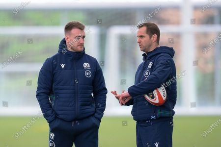 Stuart Hogg (left) speaks with specialist coach Chris Paterson (right) during the Scotland training session at the Oriam Sports Performance Centre, Heriot Watt University, Riccarton, ahead of the Six Nations match with Wales