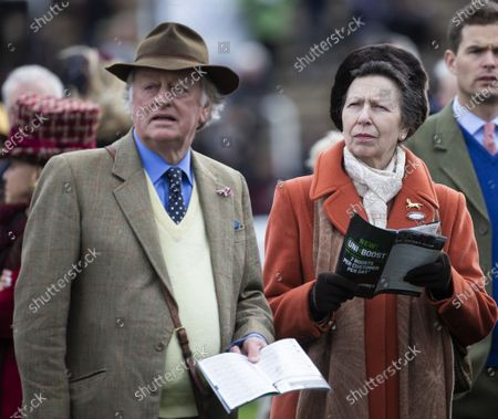 Princess Anne watches the racing with Andrew Parker Bowles.