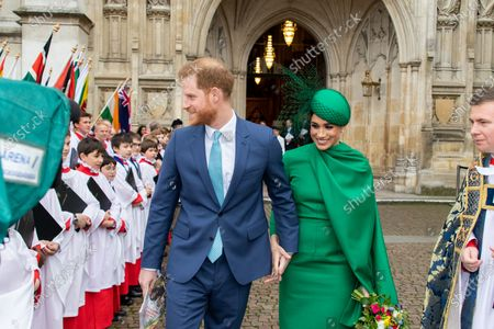 Prince Harry and Meghan Duchess of Sussex, leave the Abbey with The Dean and presented with flowers before meeting members of the performers and the Choristers