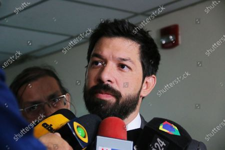 Prosecutor Osmar Legal talks to journalists before a hearing to review measures of former Brazilian soccer player Ronaldinho Gaucho and his brother, who do not appear and are represented by their lawyers, at the Palace of Justice in Asuncion, Paraguay, 10 March 2020. The judge is expected to issue a ruling on the case followed by the Brazilian soccer international and his brother after they entered the international airport of Asuncion with false passports.