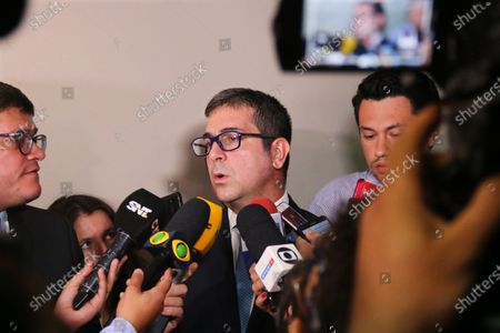 Prosecutor Marcelo Pecci (C) talks to journalists before a hearing to review measures of former Brazilian soccer player Ronaldinho Gaucho and his brother, who do not appear and are represented by their lawyers, at the Palace of Justice in Asuncion, Paraguay, 10 March 2020. The judge is expected to issue a ruling on the case followed by the Brazilian soccer international and his brother after they entered the international airport of Asuncion with false passports.