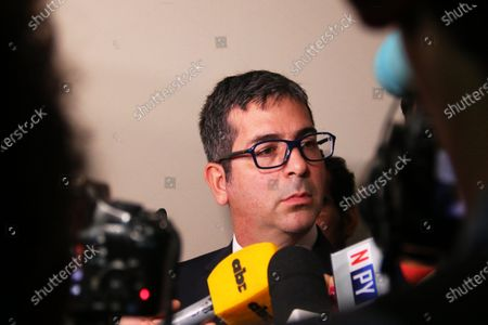 Prosecutor Marcelo Pecci talks to journalists before a hearing to review measures of former Brazilian soccer player Ronaldinho Gaucho and his brother, who do not appear and are represented by their lawyers, at the Palace of Justice in Asuncion, Paraguay, 10 March 2020. The judge is expected to issue a ruling on the case followed by the Brazilian soccer international and his brother after they entered the international airport of Asuncion with false passports.