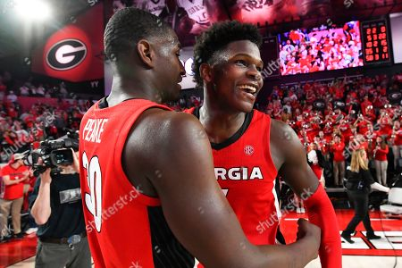 Georgia guard Anthony Edwards, right, and forward Mike Peake celebrate after an NCAA college basketball game against Auburn in Athens, Ga. Edwards was selected to the Associated Press All-SEC first team announced . Edwards was also named the AP SEC Newcomer of the Year