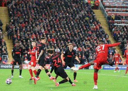 11th March 2020; Anfield, Liverpool, Merseyside, England; UEFA Champions League, Liverpool versus Atletico Madrid; Divock Origi of Liverpool shoots at goal as Sime Vrsaljko of Atletico Madrid attempts to block