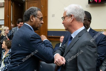 Charles Scharf, Emanuel Cleaver. Rep. Emanuel Cleaver, D-Mo., left, rubs elbows with Wells Fargo CEO and President Charles Scharf before he testifies during a hearing of the House Financial Services Committee, on Capitol Hill, in Washington