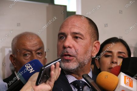 Criminal Judge of Guarantees, Gustavo Amarilla (C), appears before the media after rejecting the request for outpatient liberty or house arrest for former soccer player Ronaldinho and his brother, presented at the Palace of Justice of Asuncion, Paraguay, 10 March 2020. The judge rejected the request of the lawyers of the Brazilian international Ronaldinho and his brother to access outpatient liberty or house arrest in a mansion priced at 800,000 US dollars that was also presented as bail, so they will remain in pretrial detention. Amarilla justified his refusal of the danger of an escape from the two brothers and the political dimensions that the case is taking, which splashes to the Migration Department and the Department of Identifications, which issues passports and identity cards.
