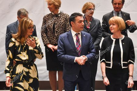 Bulgarian FM Ekaterina Zaharieva (L) gestures next to Macedonian FM Nikola Dimitrov (C) and Wendy Morton (R), UK Minister for European Neighbourhood during the ceremony of family photo on the Meeting of the Ministers of Foreign Affairs, members of the Berlin Process in Skopje, Republic of North Macedonia, 10 March 2020. Bulgaria and North Macedonia - an EU member and a candidate country will co-chair the Berlin Co-operation Process with the Western Balkan countries. For the first time, a candidate country is also at the head of the initiative. This happens in a year when North Macedonia and Albania hope for the start date for EU membership talks.