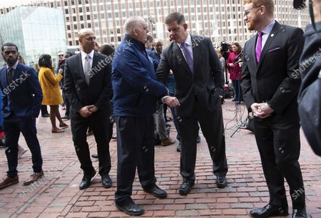 Boston's Mayor Martin Walsh (2R) avoids shaking a man's hand, after the media regarding the cancellation of the South Boston St. Patrick's Day parade and citywide precautions for the coronavirus COVID-19, outside City Hall in Boston, Massachusetts, USA, 10 March 2020. When asked about the possible cancellation of the Boston Marathon that is to take place in just under six weeks, he said, 'we are not there yet.'