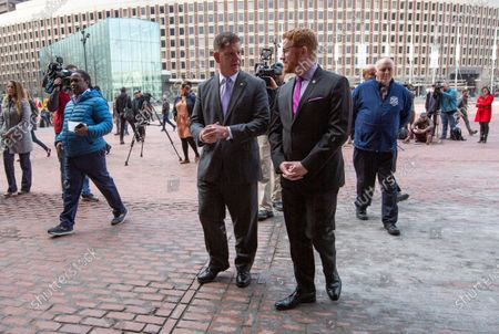 Boston's Mayor Martin Walsh (C) talks with a staff member after addressing the media regarding the cancellation of the South Boston St. Patrick's Day parade and citywide precautions for the coronavirus COVID-19, outside City Hall in Boston, Massachusetts, USA, 10 March 2020. When asked about the possible cancellation of the Boston Marathon that is to take place in just under six weeks, he said, 'we are not there yet.'