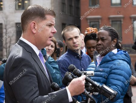 Boston's Mayor Martin Walsh (L) addresses the media regarding the cancellation of the South Boston St. Patrick's Day parade and citywide precautions for the coronavirus COVID-19, outside City Hall in Boston, Massachusetts, USA, 10 March 2020. When asked about the possible cancellation of the Boston Marathon that is to take place in just under six weeks, he said, 'we are not there yet.'