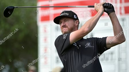 Jimmy Walker tees off on the 11th hole during the final round of the Arnold Palmer Invitational golf tournament, in Orlando, Fla