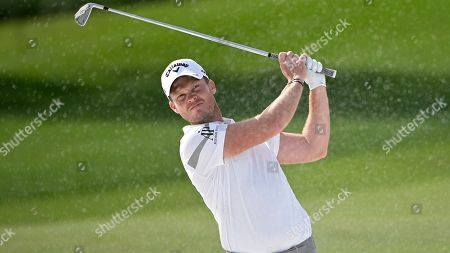 Danny Willett, of England, watches his shot from a bunker along the first fairway during the final round of the Arnold Palmer Invitational golf tournament, in Orlando, Fla