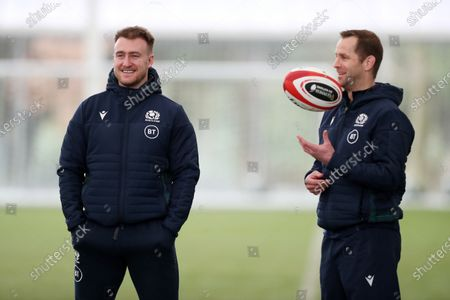 Stuart Hogg - Scotland captain sits out training as he chats with Chris Paterson (R).