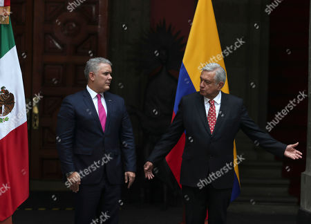 Mexico's President Manuel Andres Lopez Obrador, right, shows the way out to Colombian counterpart Ivan Duque, at the end of a welcoming ceremony at the National Palace in Mexico City