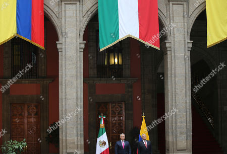 Mexico's President Manuel Andres Lopez Obrador, right, and his Colombian counterpart Ivan Duque, attend a welcoming ceremony at the National Palace in Mexico City