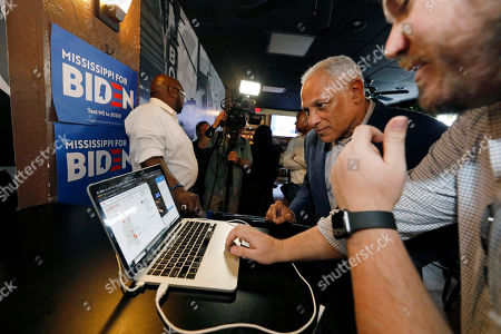Mike Espy, Joseph O'Hern. Mike Espy, second from right, and his campaign manager Joseph O'Hern, right, study election reports prior to speaking with reporters in Jackson, Miss., after winning the Democratic nomination for a U.S. Senate seat in Mississippi, . He will face Republican incumbent U.S. Sen. Cindy Hyde-Smith and Libertarian candidate Jimmy Edwards in November