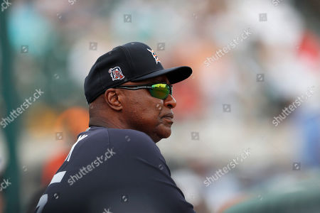 Detroit Tigers coach Dave Clark watches during a spring training baseball game against the Pittsburgh Pirates, in Lakeland, Fla
