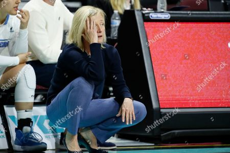 San Diego head coach Cindy Fisher reacts after a play against Portland during overtime of an NCAA college basketball game in the final of the West Coast Conference women's tournament, in Las Vegas