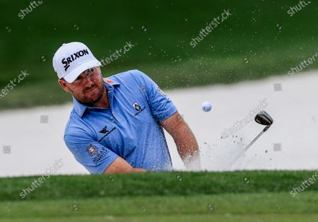 Graeme McDowell of Northern Ireland hits from a sand trap by the seventh green during practice for THE PLAYERS Championship on the Stadium Course at TPC Sawgrass in Ponte Vedra Beach, Florida, USA, 10 March 2020. The contest will run from 12 to 15 March.