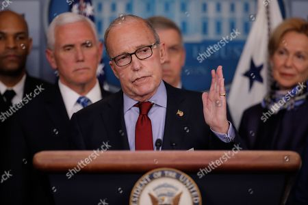 Stock Photo of White House chief economic adviser Larry Kudlow speaks in the briefing room of the White House in Washington, Tuesday, March, 10, 2020, about the coronavirus outbreak as U.S. Surgeon General Jerome Adams, Vice President Mike Pence, Coast Guard Vice Adm. Daniel Abel, and Dr. Deborah Birx, White House coronavirus response coordinator, listen