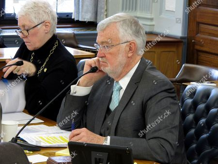 Alaska state Sen. Gary Stevens, right, listens during a Legislative Council meeting, in Juneau, Alaska. Stevens on Tuesday announced a subcommittee of lawmakers will work on contingency planning for the Legislature surrounding the new coronavirus
