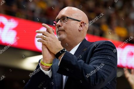 East Tennessee State head coach Steve Forbes applauds his team during an NCAA men's college basketball championship game against Wofford in the Southern Conference tournament, in Asheville, N.C. East Tennessee St. defeated Wofford 72-58