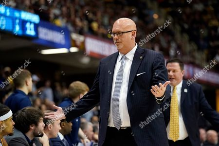 East Tennessee State head coach Steve Forbes reacts during an NCAA men's college basketball championship game against Wofford in the Southern Conference tournament, in Asheville, N.C
