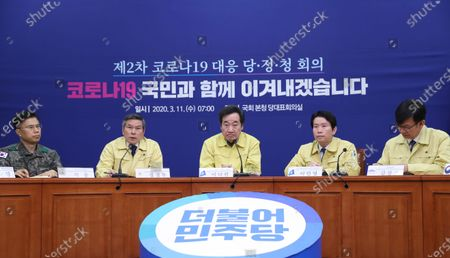 Stock Picture of (From L to R) Medical Command chief Seok-woong, Defense Minister Jeong Kyeong-doo, Lee Nak-yon, chief of the ruling Democratic Party's ad-hoc committee to fight the spread of the new coronavirus, the party's floor leader Lee In-young and Presidential Chief of Staff for Policy Kim Sang-jo attend a ruling party-government-presidential office meeting at the National Assembly in Seoul, South Korea, on 11 March 2020, to discuss measures to contain the COVID-19 virus affecting South Korea.