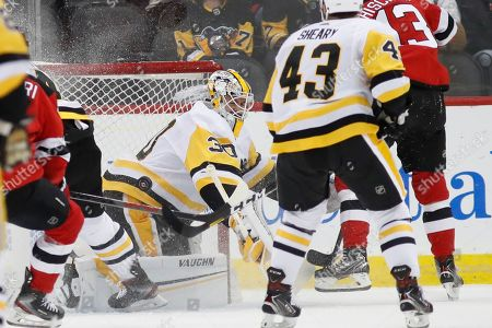 Pittsburgh Penguins goaltender Matt Murray (30) makes a save with his hip during the first period of an NHL hockey game against the New Jersey Devils, in Newark, N.J. The Penguins defeated teh Devils 5-2