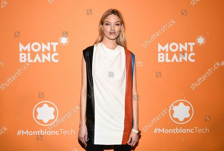 Martha Hunt attends the Montblanc MB 01 Smart Headphones and Summit 2+ launch party World of McIntosh Townhouse, in New York