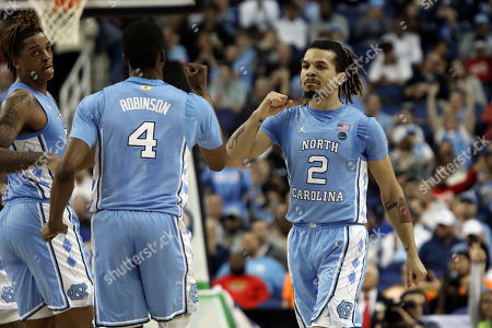 North Carolina guard Cole Anthony (2) and North Carolina guard Brandon Robinson (4) react during the first half of an NCAA college basketball game against Virginia Tech at the Atlantic Coast Conference tournament in Greensboro, N.C