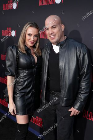 Amber Nichole Miller and Tito Ortiz at the World Premiere of Columbia Pictures' BLOODSHOT at The Village Regency.