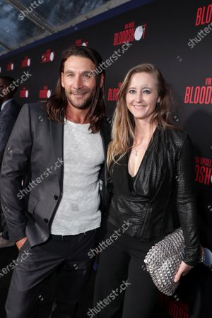 Zach McGowan and Emily Johnson at the World Premiere of Columbia Pictures' BLOODSHOT at The Village Regency.