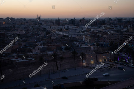 The walls surrounding the Old City are illuminated before sunrise in Tripoli, Libya. The country has been plunged into chaos since 2011, when a civil war toppled longtime dictator Moammar Gadhafi, who was later killed