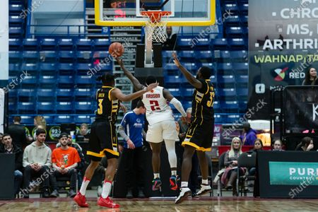 Stock Image of Braylon Rayson (middle) of Sudbury Five takes a shot against Tyrell Green (L) and Randy Phillips (R) of London Lightning