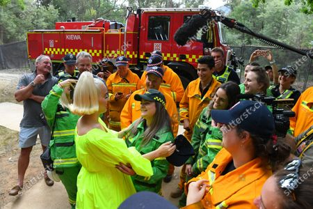 US singer Katy Perry greets emergency service personnel ahead of the 'FIGHT ON' concert for bushfire-affected communities at Pioneer Park Recreation Reserve in Bright, Victoria, Australia, 11 March 2020. The pop star is putting on a free show in Victoria's Alpine region.