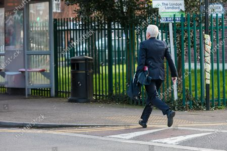 Shadow Chancellor, John McDonnell runs for a bus as he heads to Parliament from his west London home this morning. Later today, the new Chancellor of the Exchequer, Rishi Sunak will present his first budget to Parliament.