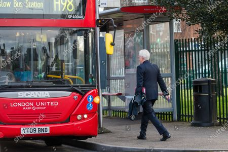 Shadow Chancellor, John McDonnell runs for a bus after leaving his west London home this morning. Later today, the new Chancellor of the Exchequer, Rishi Sunak will present his first budget to Parliament.