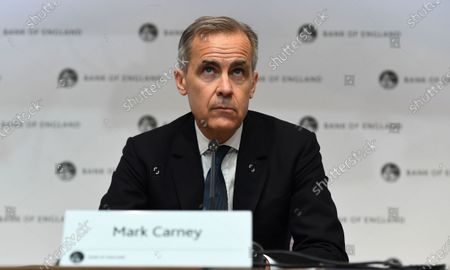 Bank of England Governor Mark Carney (C) holds an emergency press conference in London, Britain, 11 March 2020. The Bank of England has announced it has cut interest rates in response to the Coronavirus outbreak.