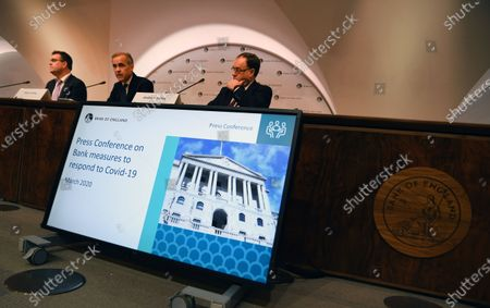 Bank of England Governor Mark Carney (C) speaks to the press during an emergency press conference in London, Britain, 11 March 2020. The Bank of England has announced it has cut interest rates in response to the Coronavirus outbreak.