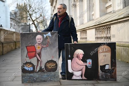 Satirical artist Kaya Mar poses with his paintings at Downing Street in London, Britain, 11 March 2020.